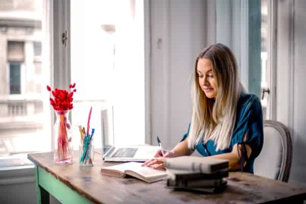 Increase Productivity Working From Home: pic of woman working at home