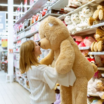 15 Easiest Items to Flip and Make Money: woman holding a teddy big bear