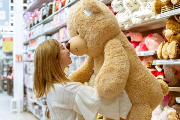 Easiest Items To Flip For Profit: pic of woman holding stuffed animal