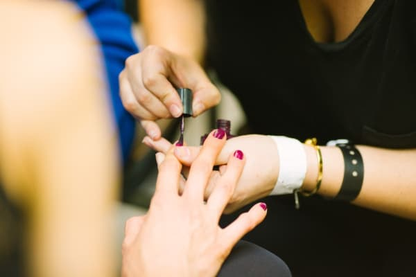 Online Nail Technician Courses: pic of manicurist doing nails