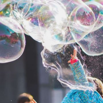 Best Bubble Machines, kid playing with bubbles