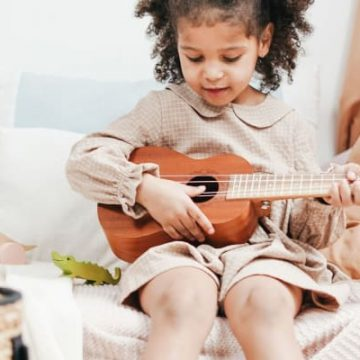 Best Musical Toys for Toddlers and Kids, pic of toddler and instrument