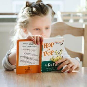 Best Kindergarten Homeschool Curriculum, pic of kindergartener reading s book