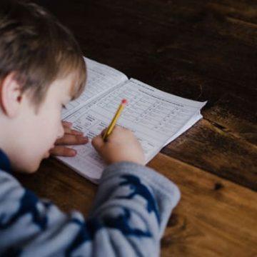 First Grade Homeschool Curriculum, pic of boy writing